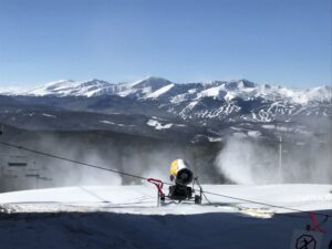 snowmaking at Keystone with Breckenridge Ski Area in Background